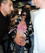 th 185421931 SG7 122 385lo Selena Gomez *BRA SLIP*, arriving at an airport in Buenos Aires   10/2/12