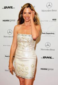 Мира Сорвино, фото 26. Mira Sorvino arrives at the Basler Show during Mercedes-Benz Fashion Week Berlin Spring/Summer 2012 at the Brandenburg Gate on July 6, 2011 in Berlin, Germany., photo 26