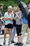 http://img163.imagevenue.com/loc901/th_61600_Kate_Hudson_and_Anne_Hathaway_shade_under_an_umbrella_CU_ISA_030608_03_122_901lo.jpg